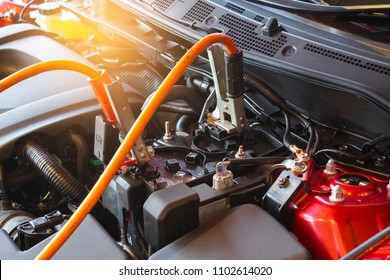 Charging battery car on blurry background.Metaphor Recharge energy Startup or electrical energy and Comparable to encouragement image.