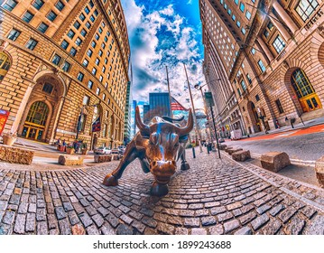 Charging Bull is a bronze sculpture that stands on Broadway, north of Bowling Green in the Financial District of Manhattan, Wall Street, New York, United States. 01.17.2021