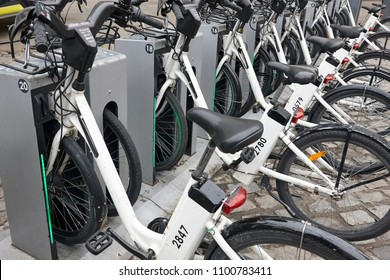 Charging electric bikes in the city. Urban green transportation. Horizontal