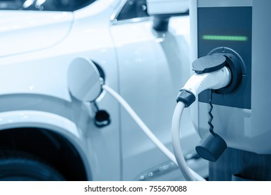 Charging an electric car battery, Blue tone