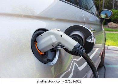Charging an electric car on a  parking lot