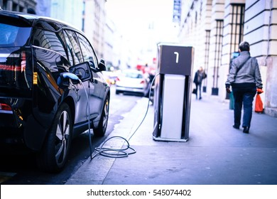 Charging electric car on the street