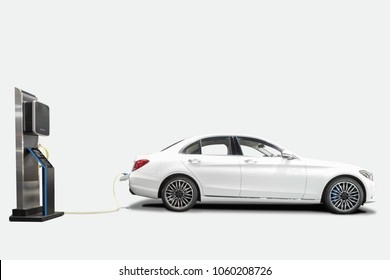 Charging an electric car with station for clean energy future of transportation ecology concept isolated on white background with clipping path