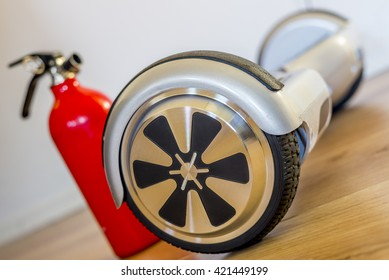 charging a hoverboard with fire extinguisher nearby