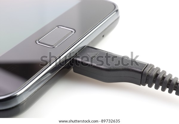 Charging of mobile phone on  white background.