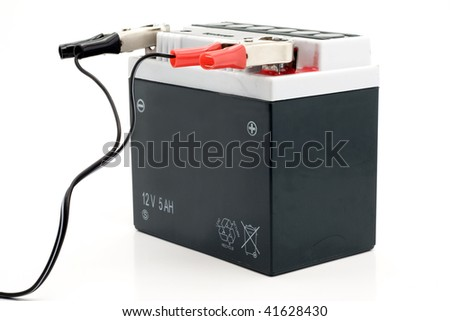 Charging motorcycle battery isolated on white background