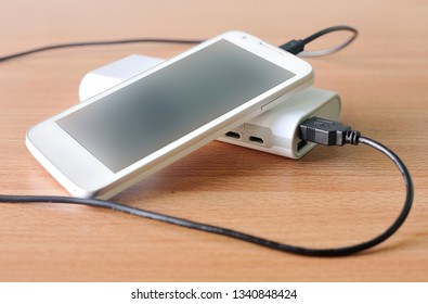 Charging the smartphone's battery with power bank, powerbank, preventive and secure technology device.
