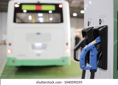 Charging station of an electric car in the background of a bus