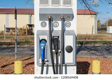 Charging station for electric cars with different plugs