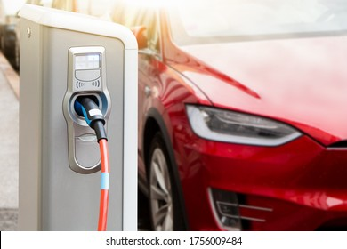 Charging station on the background of an electric car.