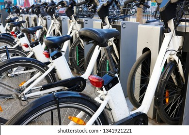 Charging urban electric battery bikes in the city. Eco transport