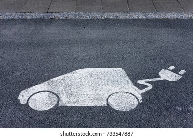 Charging/Parking sign for electric vehicle applied on asphalt in Norway