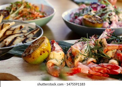 Chargrilled king prawns with smoked garlic butter; Watermelon and marinated fetta salad; Hand rolled grilled flat bread; Smoked root vegetables
