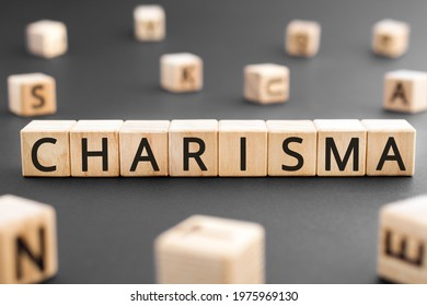 Charisma - word from wooden blocks with letters, Charisma concept, random letters around black background