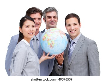 Charismatic business team looking at a terrestrial globe against a white background