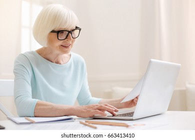 Charismatic intelligent lady writing an email