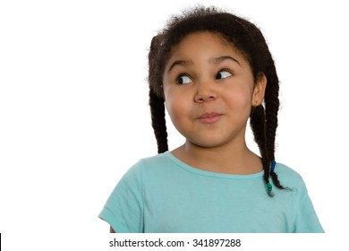 Charismatic little African American girl looking sideways with a cute knowing smile and speculative look, head and shoulders isolated on white with lateral copyspace