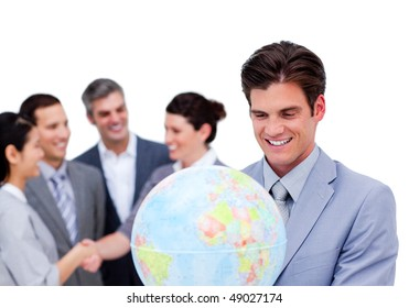 Charismatic manager and his team holding a terrestrial globe against a white background