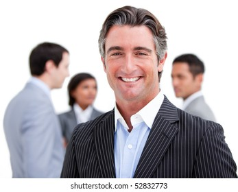 Charismatic mature businessman standing with his team against a white background