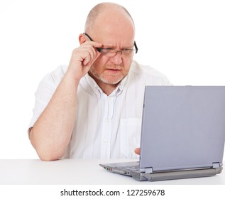 Charismatic middle aged man got a problem with his laptop. All on white background.