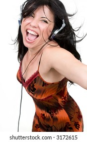 Charismatic woman dancing and enjoying upbeat music