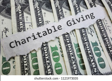 Charitable Contribution paper message on hundred dollar bills