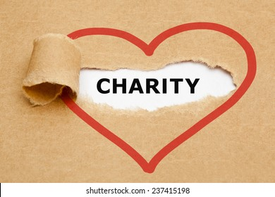 Charity appearing behind torn brown paper.
