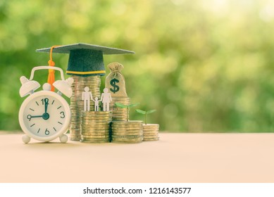 Charity for education, donate for child education concept : Black graduation cap, US dollar money bag, family member paper cut, white clock and coins, depicts financial aid and opportunity give to kid