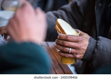 Charity. The fight against poverty. Volunteers handed out hot meals to people in need. Cold winter day in the big city.