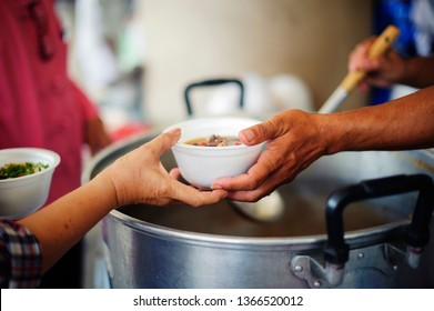 Charity food is the hope of the poor who have no money: concept of begging food : Volunteers Share Food to the Poor to Relieve Hunger