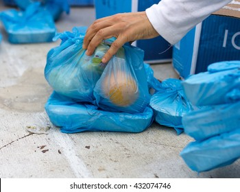 Charity and giving is an integral part  of the holy month of Ramadan: distributing donated food packages to workers. Dubai, United Arab Emirates - 03/JUL/2015