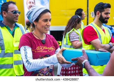 Charity and giving is an integral part of the holy month of Ramadan: distributing donated food packages to workers. Dubai, United Arab Emirates - 17/JUL/2016