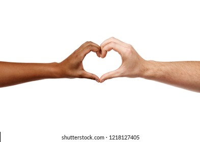 charity, love and diversity concept - close up of female and male hands of different skin color making heart shape
