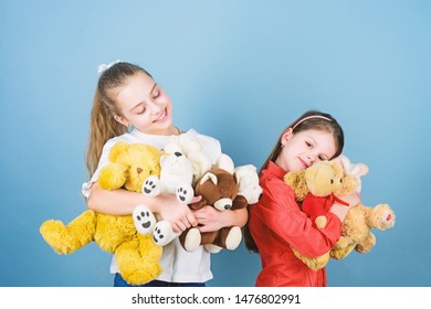 Charity sale. Love and friendship. Kids adorable cute girls play soft toys. Happy childhood. Child care. Sisters best friends play. Sweet childhood. Childhood concept. Softness and tenderness.