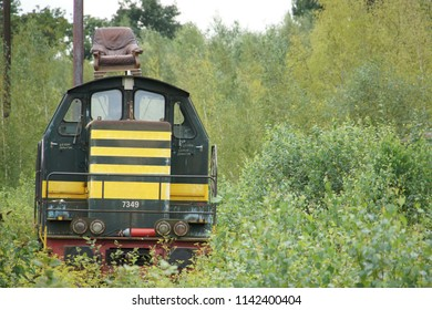 Charleroi, Belgium - August 28 2011: Abandoned Belgian train locomotive with leather seater on top.