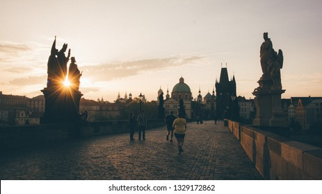 Charles bridge and the baroque statues in the morning sunlight, Prague, Czech Republic, 3rd May 2018
