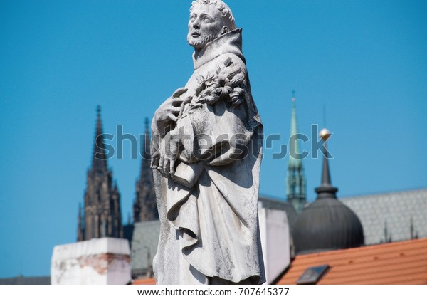 Charles Bridge is an historic bridge that crosses the Vltava river in Prague.