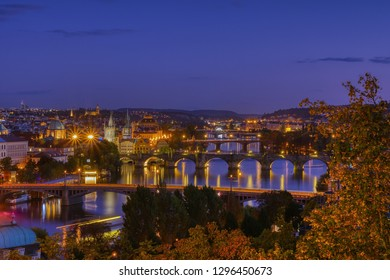 Charles bridge, Karluv most and Lesser town tower, Prague in autumn at sunrise, Czech Republic.