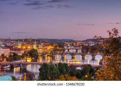 Charles bridge, Karluv most and Lesser town tower, Prague in autumn at sunset, Czech Republic.