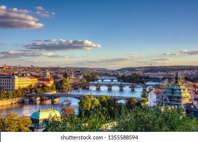 Charles bridge, Karluv most and Lesser town tower, Prague in spring at sunrise, Czech Republic.