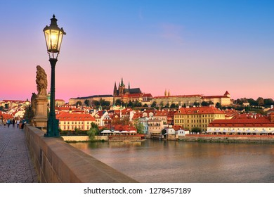 Charles Bridge in the morning with old Prague and St. Vitus cathedral at dawn