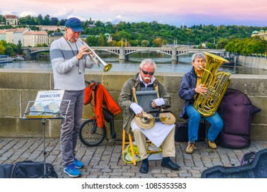 Charles Bridge the musicians playing the romantic song while across the famous Bridge  the Vltava River Prague Czech Republic 19th September 2017