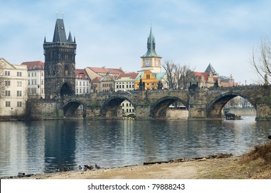 Charles bridge and Old Tower, look from Vltava bank. Czech Republic