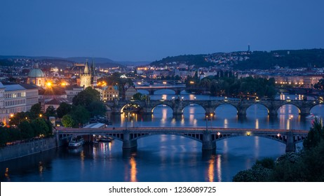 Charles bridge and Old Town bridges tower with Vltava river view in night time taken from Letensky profil