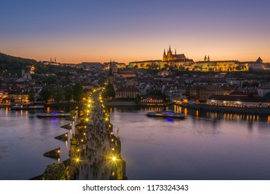 Charles bridge, Prague castle and St. Vitus cathedral in evening view taken from Old Town bridge tower