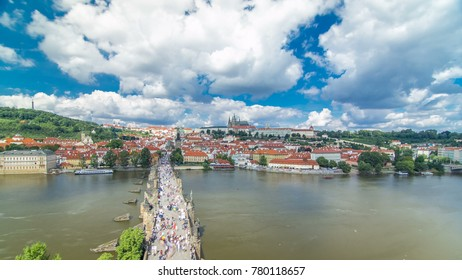 Charles Bridge and Prague Castle timelapse, view from the Bridge tower, Czech Republic. Cloudy sky at sunny day
