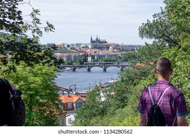 Charles Bridge and Prague Castle from Vysehrad with people silhouettes