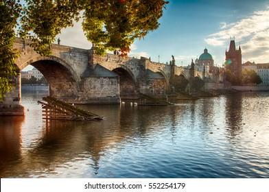 Charles bridge in Prague during morning sunset, close-up.