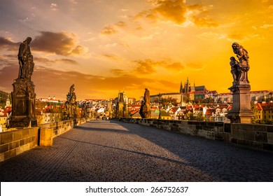 Charles bridge with statues and Prague castle on surise. Prague, Czech Republic
