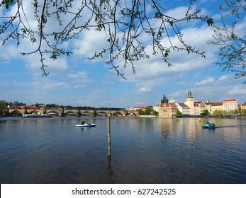 CHARLES BRIDGE AND VLTAVA RIVER - PRAGUE, CZECH REPUBLIC APR 14, 2017 : Beautiful view of historic Charles bridge and Vltava river in Prague, Czech republic.